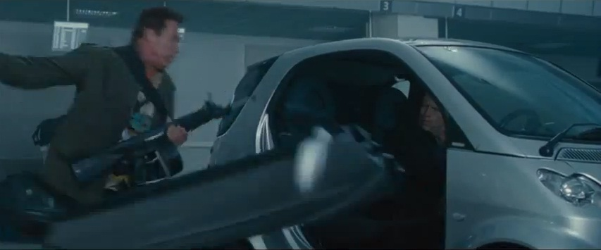 Watch Swarchenegger swipe the door off a smart car in The Expendables 2